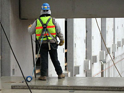 Worker in safety harness